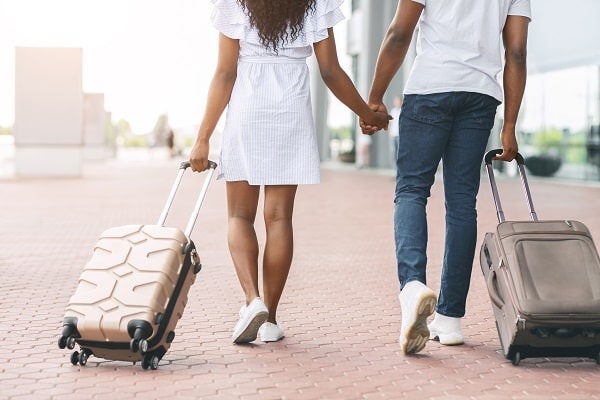 millennial african travellers going with luggage a H8U26MC